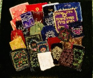 LARGE COLLECTION OF TALLIT, TEFILLIN AND AFIKOMAN BAGS